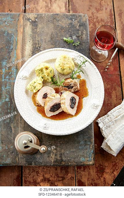 Pork fillets with plums and dumplings