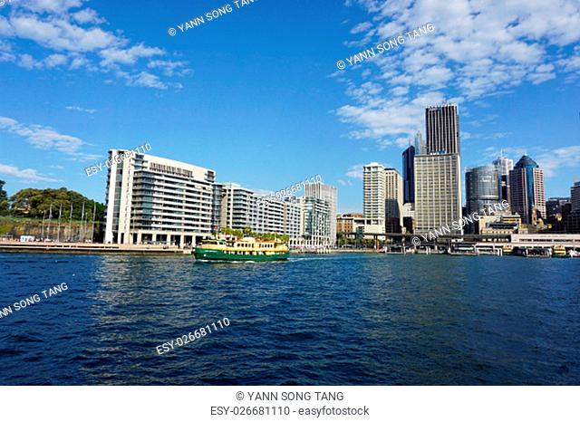 SYDNEY, AUSTRALIA - JUNE 20, 2016:: Sydney city CBD towers and office buildings above Royal botanic garden across Harbour waters on a sunny day