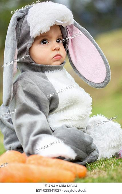 Little baby girl wearing a rabbit costume