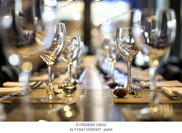Wineglasses arranged on dining table