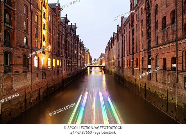 Speicherstadt with light effect from boat in Hamburg