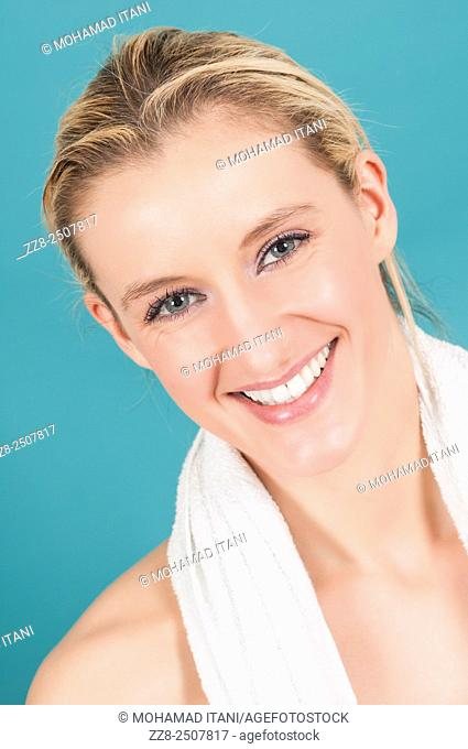 Beautiful young Caucasian woman with a white towel smiling