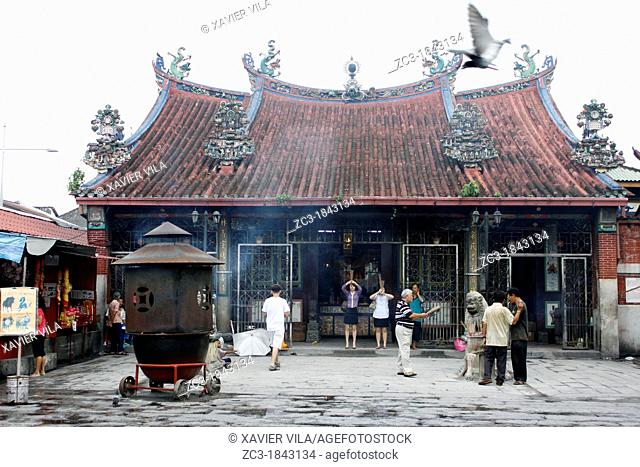 Incense burner near a sacred tree and a chinese temple, Goddess of Mercy Temple, UNESCO World Heritage Site, Georgetown, Penang Hill