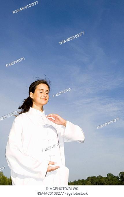 Young woman practising Qi Gong