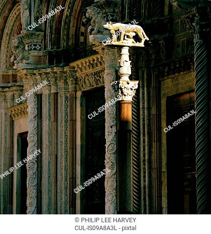Statue of Lupa, the Roman she-wolf in front of Duomo Cathedral. Siena, Italy