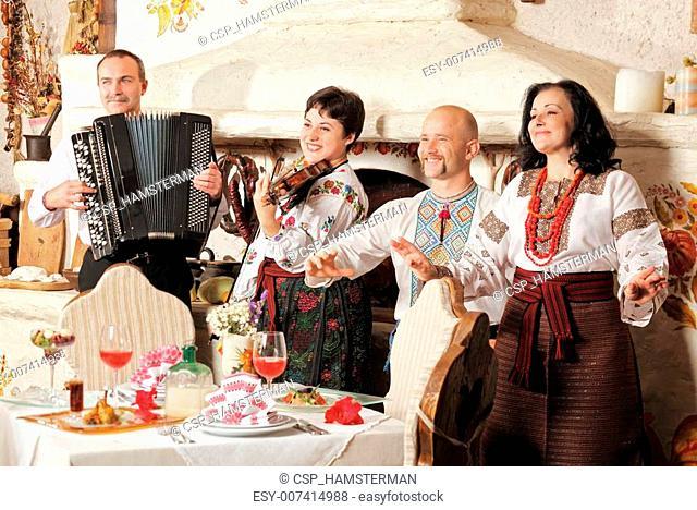 Ukrainian ethnic music band concert in traditional restaurant interior