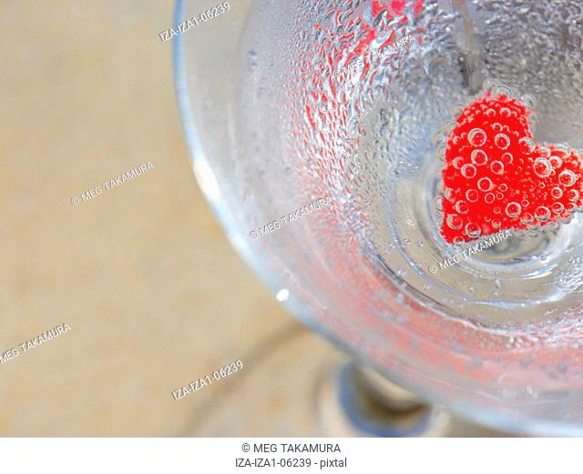 High angle view of a heart shape stuffed in a glass of martini
