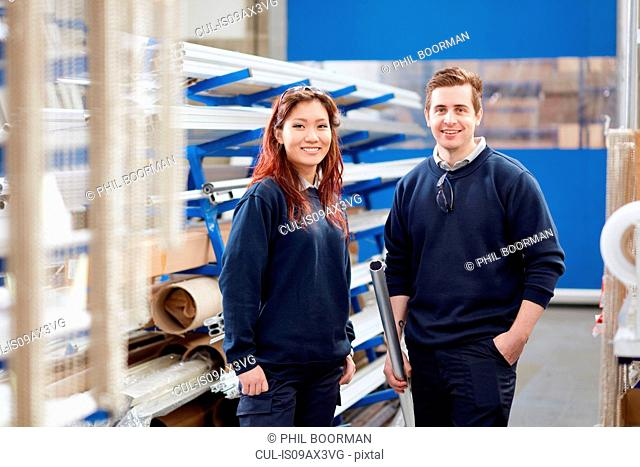 Portrait of manger and young female worker in roller blind factory