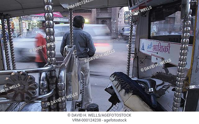 View of crowded street from interior of an auto rickshaw in Jodhpur, Rajasthan, India
