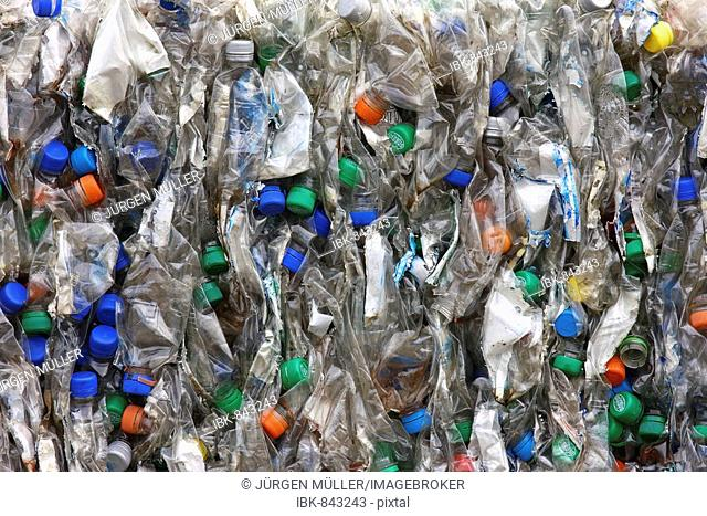 Colourful crushed, compacted plastic bottles for recycling