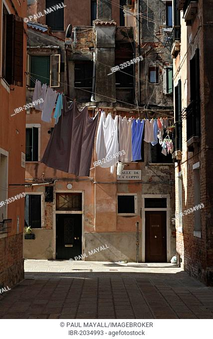 Clothes washing hanging out to dry between houses, Venice, Italy, Europe