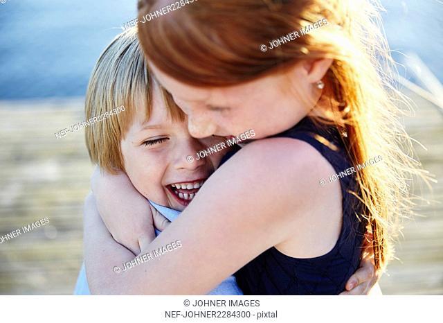 Girl hugging boy