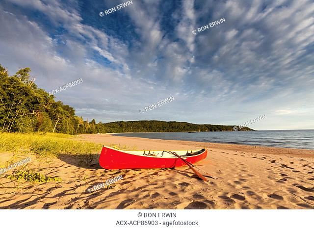 Red canoe and clouds at Gargantua Bay, Lake Superior Provincial Park, Ontario, Canada