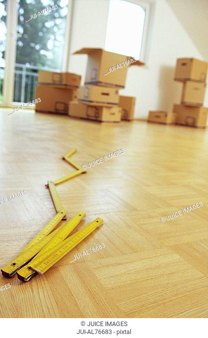 Tilted view of a collapsible yard-stick on the floor