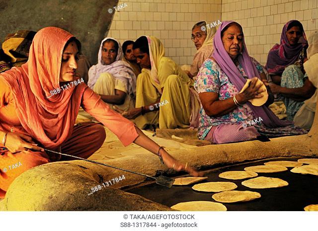 Women make capati for hundred of pilgrims at Gurudwara Temple, Himachal Pradesh India