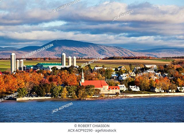 On the Saint Lawrence River, just a few kilometres downstream from Quebec City is the Island of Orleans. The village depicted in the photograph is...