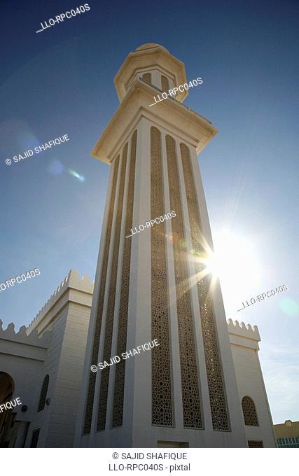 Low angle view of Mosque minaret. Umm Al Quwain, United Arab Emirates