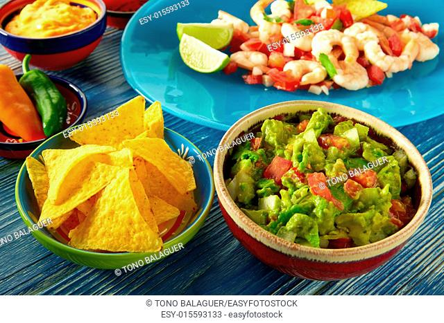 Guacamole mexican food with shrimp ceviche nachos and chili peppers