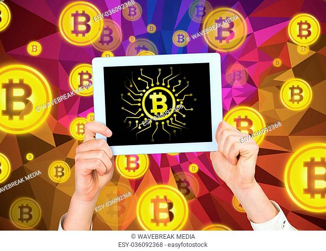 Bitcoin icons and hands holding tablet