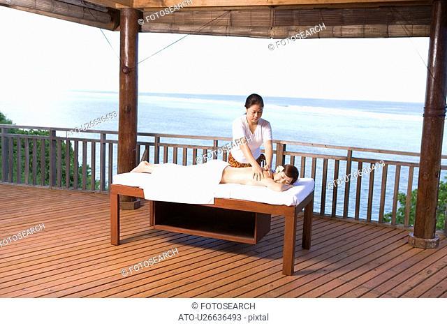 Young woman getting a massage, Saipan