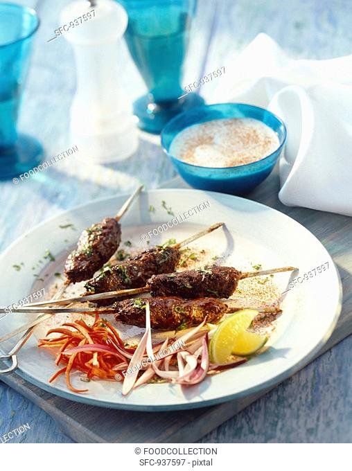 Minced lamb kebab with a yogurt dip