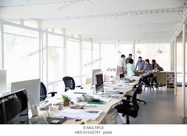 Architects meeting in open plan office
