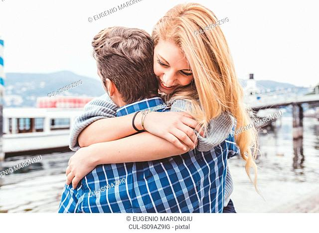 Young couple hugging on lakeside, Lake Como, Italy