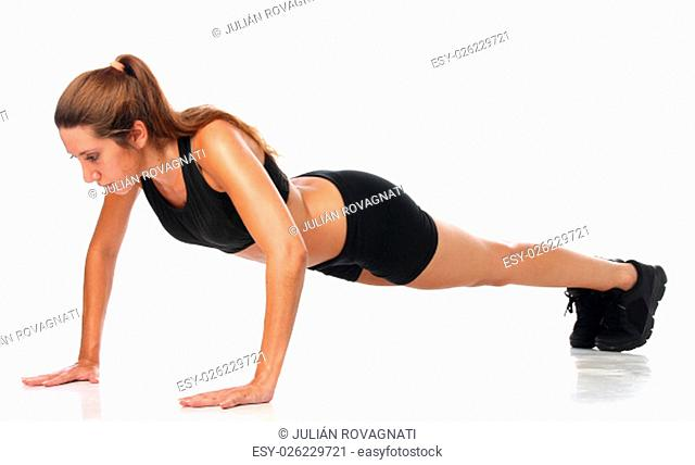 Happy young woman holding doing exercise and stretching over white