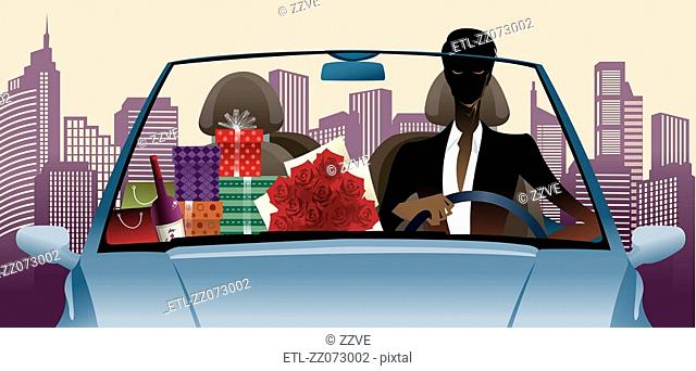 Portrait of man driving car with gifts by side