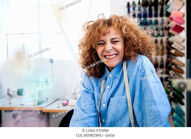 Seamstress looking at camera smiling