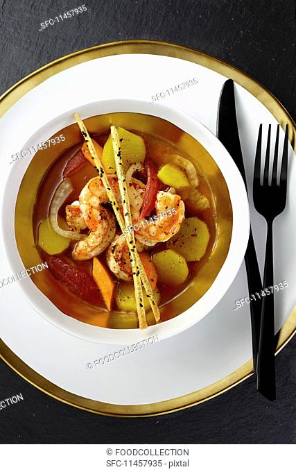 Clear prawn soup with tomatoes, fennel seeds and lemongrass