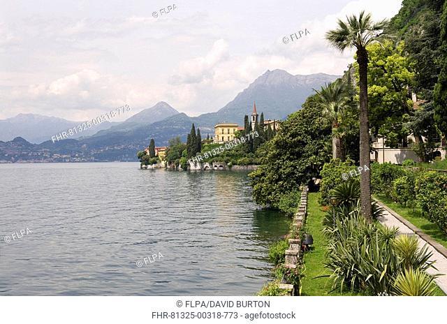 View of lake and lakeside gardens, Villa Monastero, Varenna, Lake Como, Lombardy, Italy