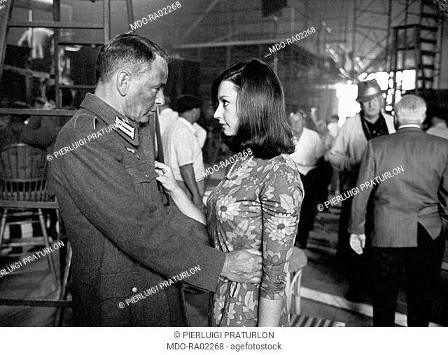 American actor Frank Sinatra hugging Italian actress Raffaella Carrà in Von Ryan's Express directed by Mark Hobson. 1965