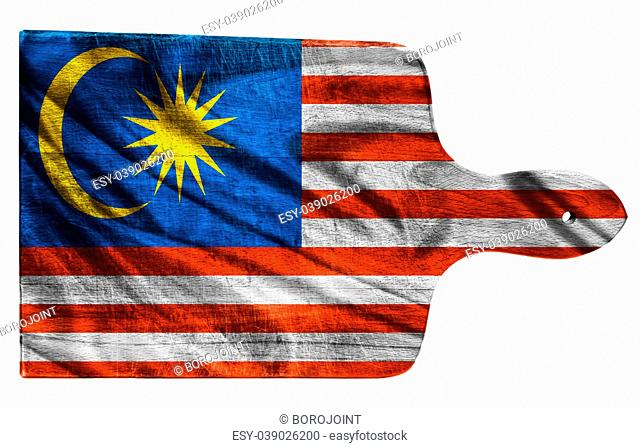 Textured Malaysia flag painted on old heavily used chopping or cutting board on white background