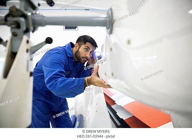 Helicopter mechanic examining panel