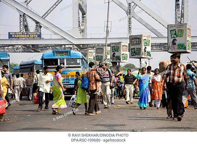Street Scene ; View of Howrah Bridge now Rabindra Setu over River Hooghly ; Calcutta Kolkata ; West Bengal ; India