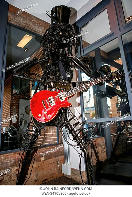 A unique sculpture of rock musician Slash is going under the hammer. The larger-than-life, 7.5 feet tall work has been painstakingly fashioned from recycled car