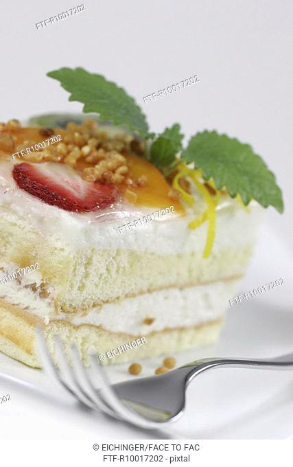Pastry slice on plate with fork, close-up