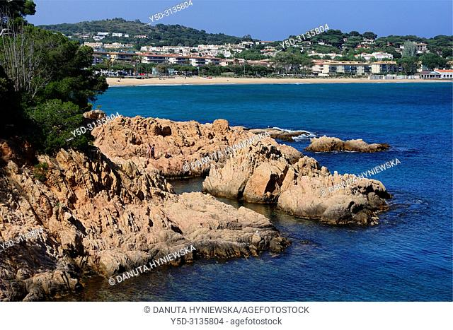 Sant Feliu de Guixols resort, rocky coastline, in background Sant Pol sandy beach, Sant Pol beach is a passage between resorts S'Agaro and Sant Feliu de Guixols