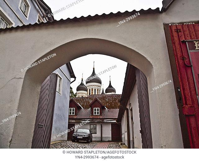 Archway over a driveway at Kiriku Plats, or Dome Square, In Tallinn, Estonia. The domes of Alexander Nevsky Cathedral are beyond