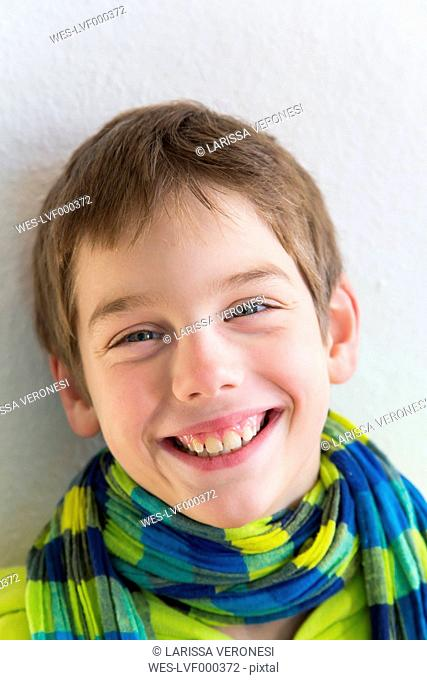 Portrait of smiling young boy with hoodie jacket and scarf