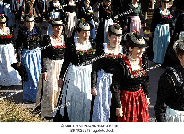 Women wearing traditional costumes during a procession on Leonhardifahrt, the feast day of Saint Leonard of Noblac, Kreuth, Tegernsee Valley, Upper Bavaria