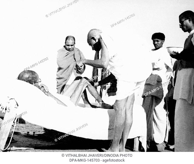 Mahatma Gandhi giving massage 15 min daily to leper patient Sanskrit scholar Parchure Shastri at Sevagram Ashram , 1940