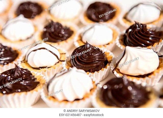 white and black meringue cookies. Creative background