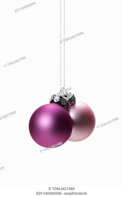pink christmas balls isolated hanging with white background