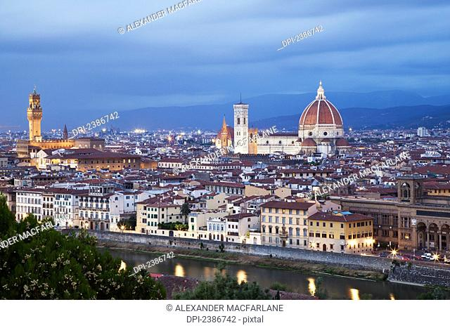Cityscape of Florence and Basilica of Saint Mary of the Flower under a cloudy sky; Florence, Tuscany, Italy