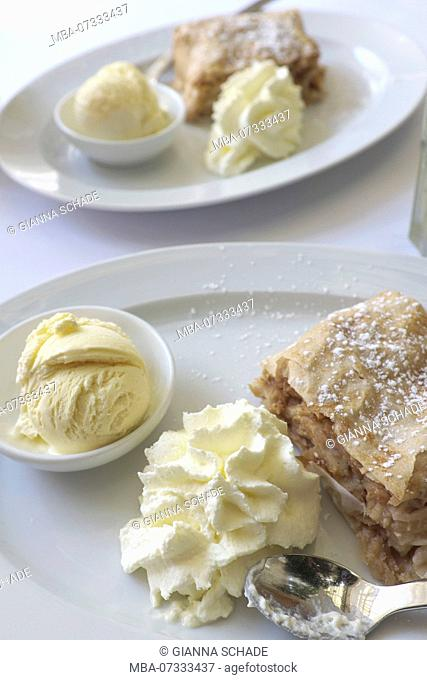 Apple strudel with ice cream and cream