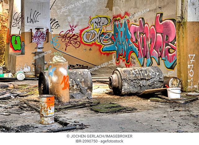 Paper rolls, graffiti, abandoned factory