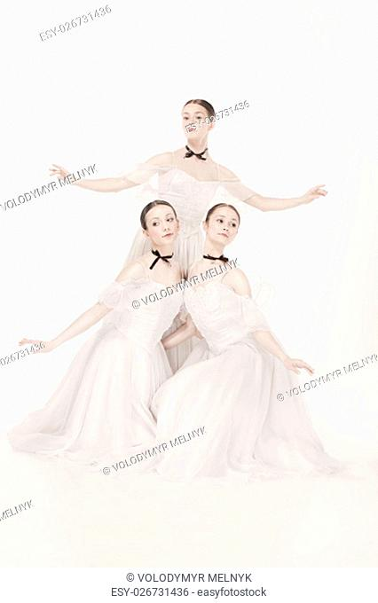 Romantic Beauty. The portrait of a three women as ballerinas in retro style