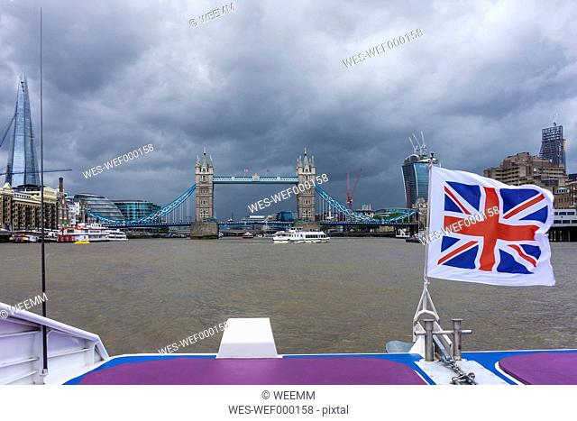 England, London, Southwark, view to the Tower Bridge with blowing Union Jack in the foreground